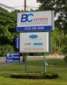 BC Express Heating and Air Conditioning Signage with logo and phone number, showroom and brands including Carrier, Mitsubishi Electric and Energy Star.