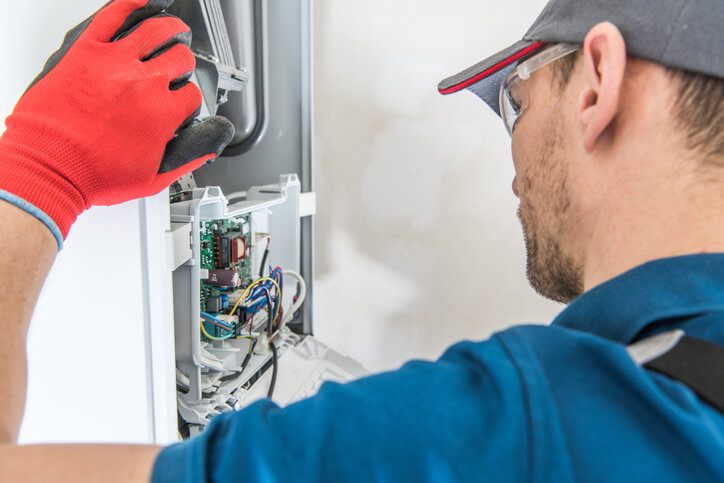 HVAC Specialist performing annual maintenance on the heating system