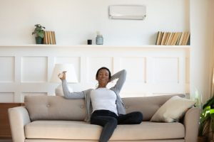 woman relaxes on couch in comfortable living room