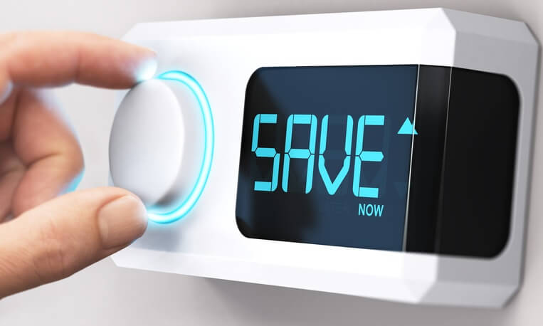 Someone adjusting a digital thermostat, and the word Save is where the temperature reading would normally be.